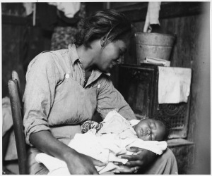 Near_Buckeye,_Maricopa_County,_Arizona._Migrant_(African-American)_cotton_picker_and_her_baby._-_NARA_-_522540