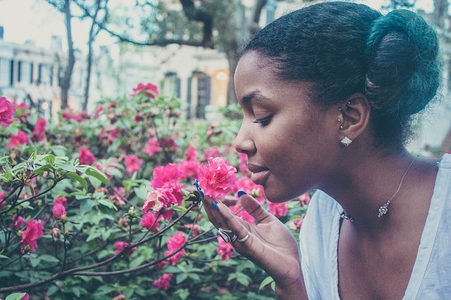 oung black woman and flowers